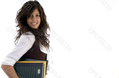 portrait of college student holding study material