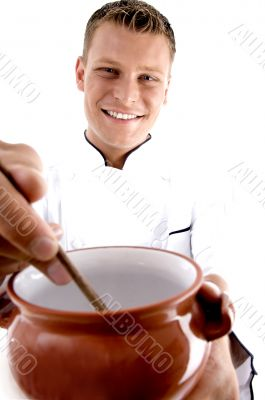 smart chef cooking in porcelain pot