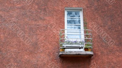 old balcony with flowers on the wall