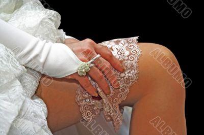 A bride on her garter on her leg