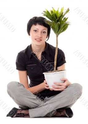 young woman with indoor plants