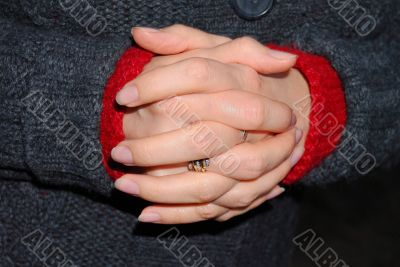 womanish hands touch to the woolen clothes