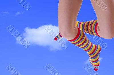 jumping woman legs in stripped socks