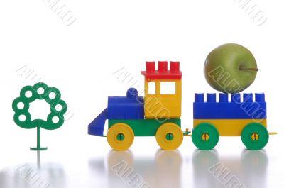 toy plastic train, isolated white background