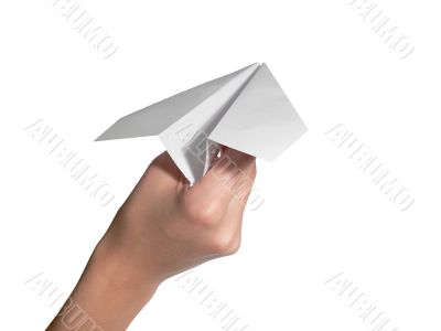 The female hand starts the paper plane