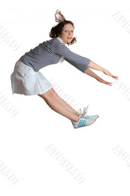 Happy energetic cute girl jumping into the air