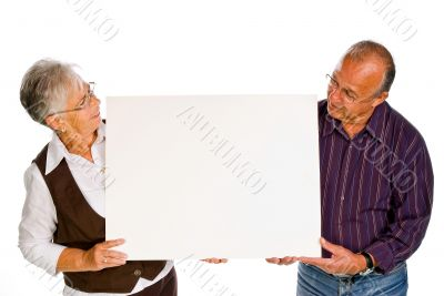 man & woman holding a blank over white background