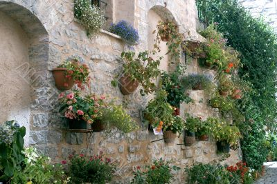 Spello - Potted plants and flowers hanged to an old house