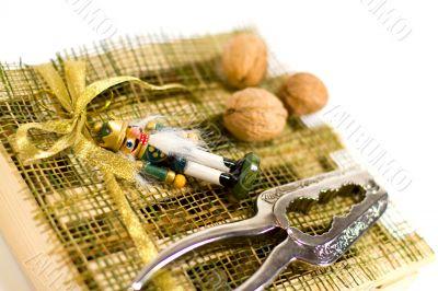 nutcracker, walnuts and decorations