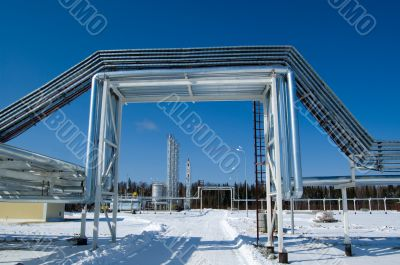 Industrial zone, Steel pipe-lines on blue sky