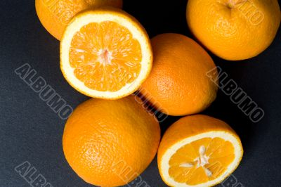 Six orange fruits