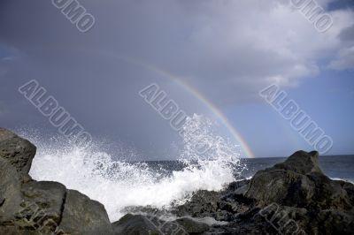 ocean waves and rainbow