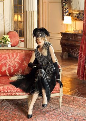 Aristocratic woman sitting in castle hall