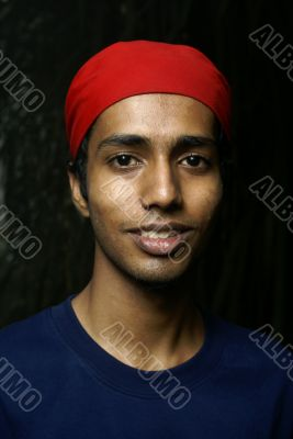 Indian man with red headwear