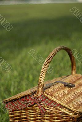 Picnic hamper basket in field