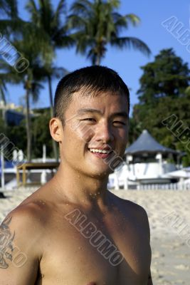 Fit asian man at beach