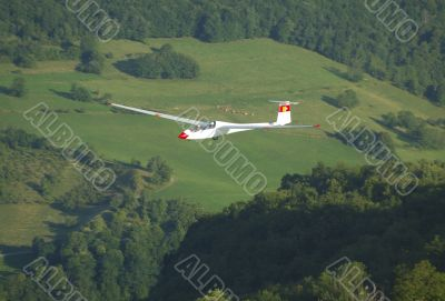 A glider Janus flying over Challes les eaux