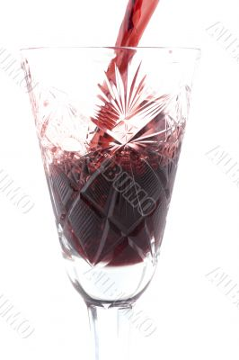 wineglass with wine on white