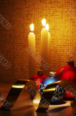 candles, balls and gold ribbons it are Christmas