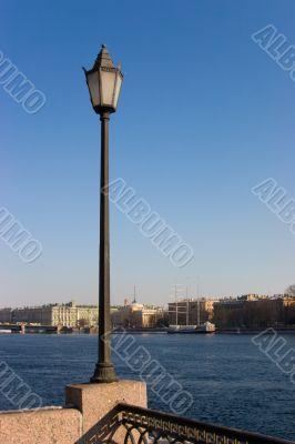 The lantern over embankment of the rive Neva