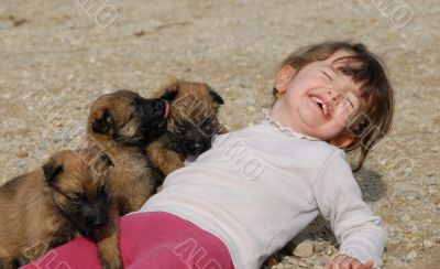 laughing girl and puppies