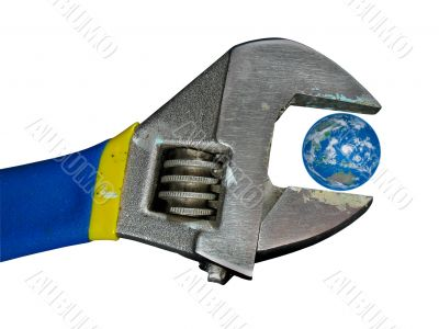 Concept planet earth globe in old adjustable spanner wrench isolated over white