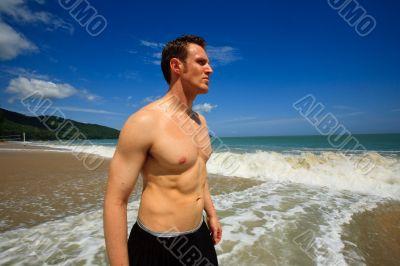 Man standing on exotic beach