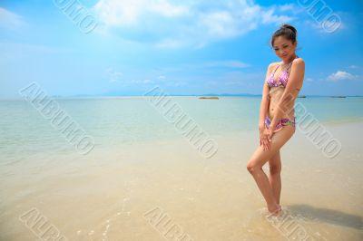 beautiful asian woman on a beach