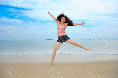 happy fun jump at the beach