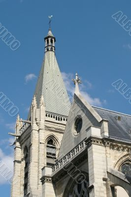 French church belltower on the blue sky background
