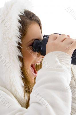 happy female using binocular to watch