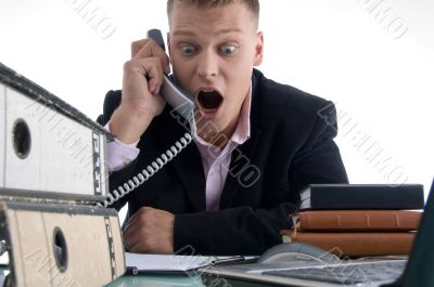 shocked businessman holding receiver