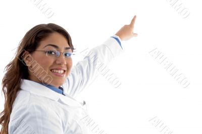 smiling female pointing with finger