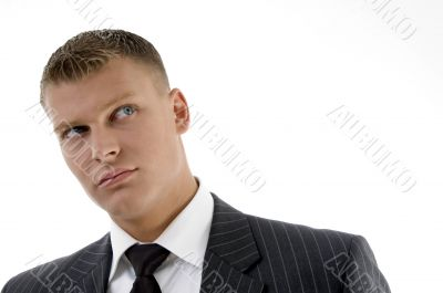 close up of handsome businessman looking upward
