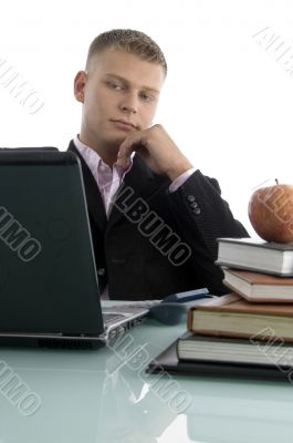 young businessman looking into laptop