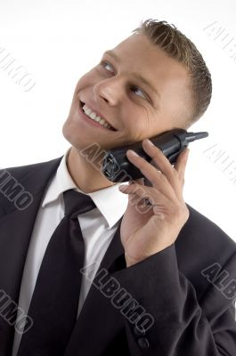 young businessman smiling and talking on phone