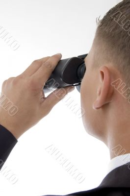 young accountant posing with binoculars