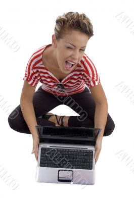 winking beautiful model with laptop