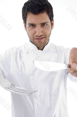 portrait of male chef holding cutlery