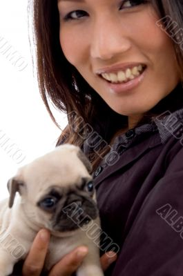 pleased woman with cute puppy