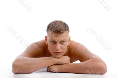 laying muscular male looking at you