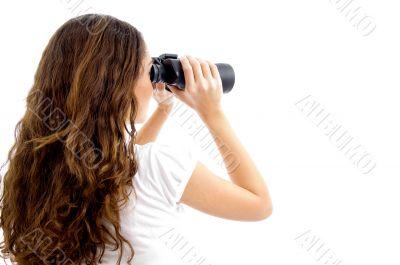 teenager girl watching through binocular