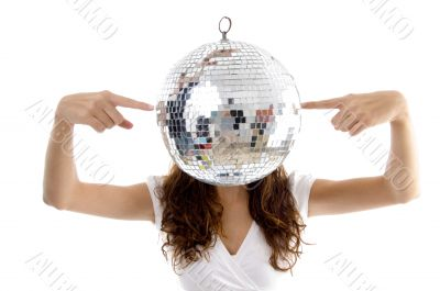 woman balancing mirror ball with fingers