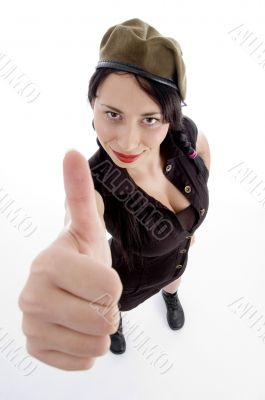 young fashionable female posing with thumbs up