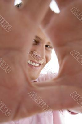 pleased man showing framing gesture