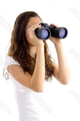 attractive model watching through binocular