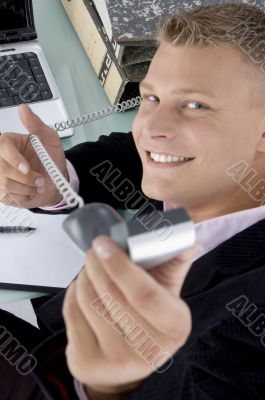 executive showing phone