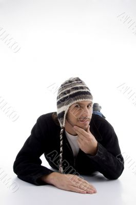 young male lying and wearing woolen cap