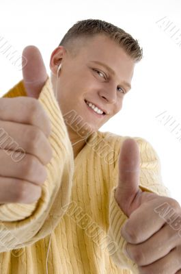 smiling guy showing good luck sign with both hands