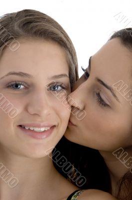 female kissing her friend